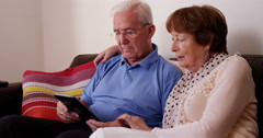 4k, A senior couple shopping online using laptop Stock Footage