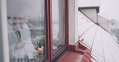 Young Woman lighting Advent Candles on the Window. 4K DCi SLOW MOTION 120 fps. Stock Footage