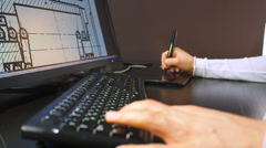 Close up of the hand of a engineer editing scheme in CAD system Stock Footage