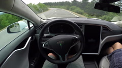 FPV: Environmentally friendly electric car self driving on winding road Arkistovideo
