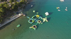 Aerial view of inflated water park on the sea, aqua park Stock Footage