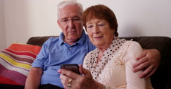 4k, Mature couple reading a text message on their smart phone. Stock Footage