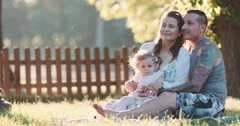 Young family with Toddler Girl Relaxing in the Park. Slow Motion 120 fps 4K Stock Footage