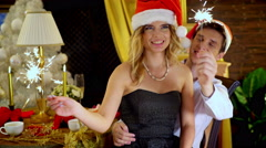 Couple in Santa hat celebrate Xmas New Year in restaurant. Stock Footage