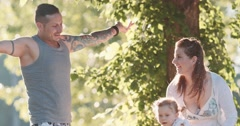 Parents with Baby Girl Enjoying Sunny day in the Park. Slow Motion 120 fps 4K. Stock Footage
