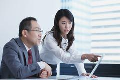 Japanese businesspeople in a modern office Stock Photos