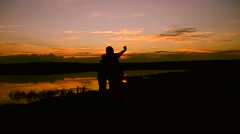 Children with mother make selfie phone at sunset Stock Footage