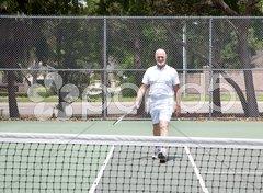 Senior Man on Tennis Court Stock Photos