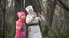Girls in the forest make a selfie Stock Footage