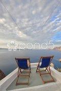 Sunbeds on Santorini Stock Photos