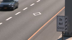 High occupancy vehicle lanes on QEW highway in Oakville Canada Stock Footage