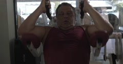 Grown man in the gym performing exercises on the upper abs Stock Footage