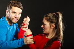 Man husband fighting with woman wife. Violence. Stock Photos