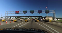 Driver's Perspective Going Through Tollbooth Plaza Stock Footage