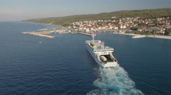 Aerial view of arriving ferry boat - Jadrolinia, Supetar, Brac, Croatia Stock Footage