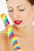 Portrait of woman with a lollypop Stock Photos