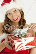 Portrait of female Santa Claus with Christmas present Stock Photos
