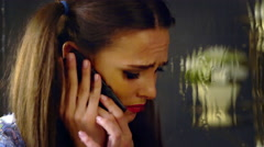 Girl talking on phone and crying. Stock Footage