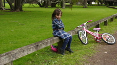Sad little girl do not know how to ride a bike Stock Footage