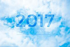 2017 Happy new year on nice blue sky with cloud,Holiday celebration greeting  Stock Illustration