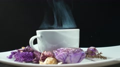 Steaming Cup of tea with flowers rotation Stock Footage