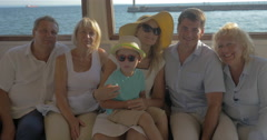 Happy family child mother father grandparents are sitting on closed deck of boat Stock Footage