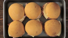 Ham and cheese sliders on homemade dinner rolls. Stock Footage