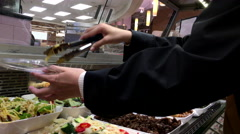 Woman buying side dish inside T&T supermarket with 4k resolution Stock Footage