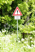 Road sign on overgrown road Stock Photos
