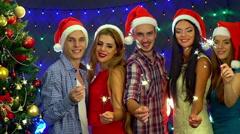 Group people in Santa hat dancing in New Year nightclub. Slow motion. Arkistovideo