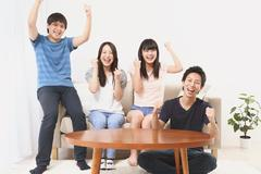 Group of Japanese supporters in the living room Stock Photos