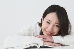 Japanese High-school student in uniform against white background Kuvituskuvat