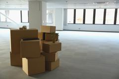 Boxes in an empty office Stock Photos