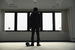 Japanese businessman with ball and chain Stock Photos