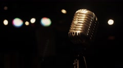Concert vintage glare microphone on stage in empty retro club. White spotlights Stock Footage