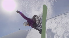 SLOW MOTION: Young pro snowboarder sliding on half pipe wall in sunny snowpark Stock Footage