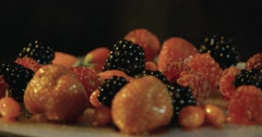 Fresh fruits raspberries blackberries and strawberries on a rotating plate Stock Footage