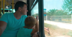 In city of Perea, Greece in bus are going father and son Stock Footage