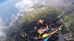 Tandem paragliding. Fear and joy. Extreme touristic Attraction. Stock Footage