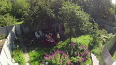 Big family serve the table and dine in the summer courtyard. Time Lapse Stock Footage