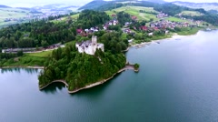 Aerial view of castle on lake bank Stock Footage