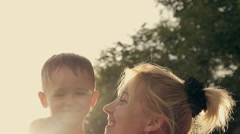 At the evening time before the sunset, baby feeling happy and smiles with her Stock Footage
