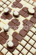 Chocolate bars with chocolate candies Stock Photos
