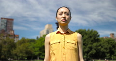Asian woman in city park walking sad face depressed Stock Footage