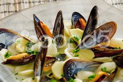 Mussels soup with pasta orecchiette Stock Photos