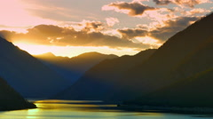 4K Sunset Golden Hour Mountains Silhouette, Yellow Sun Rays and Clouds Stock Footage