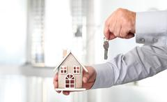 Hands with house and Key, real estate concept Stock Photos
