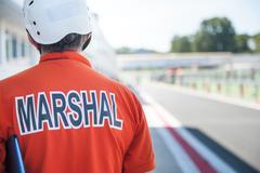 Motorsport track marshall racing bib close up Stock Photos