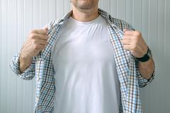 Guy revealing white t-shirt as copy space Stock Photos