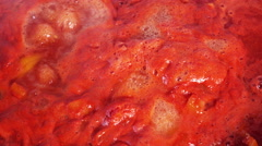 Cooking tomato paste Stock Footage